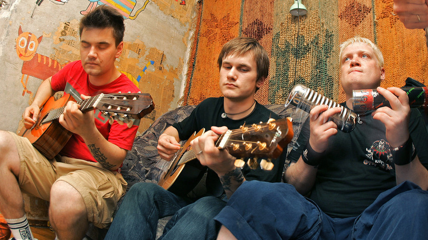 "The picture shows members of the popular rock group Lumen. Young people giving an informal concert during a flat party in Kapelsky Lane. Such so called ""kvartirnik"" concerts became a successful start for many newly formed groups."