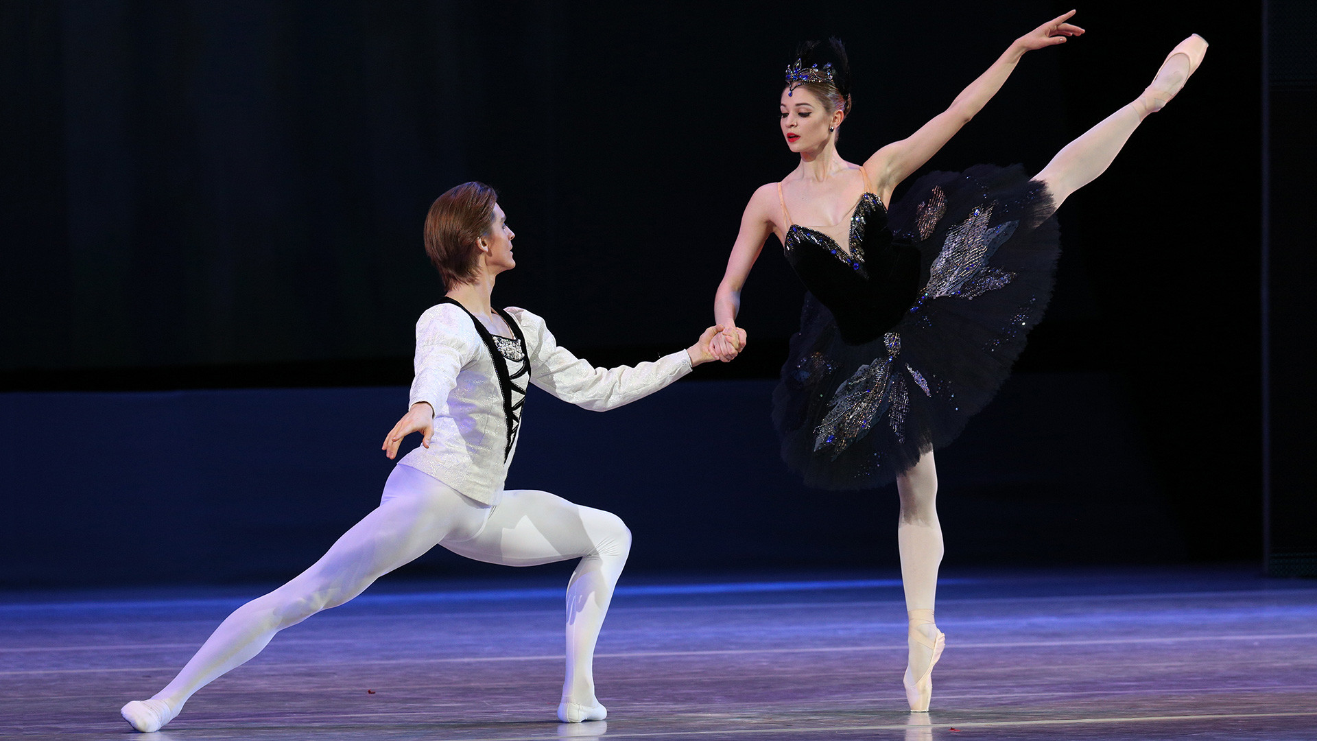 Angelina Vorontsova and Denis Rodkin performing a piece from Swan Lake on the stage of The State Kremlin Palace.