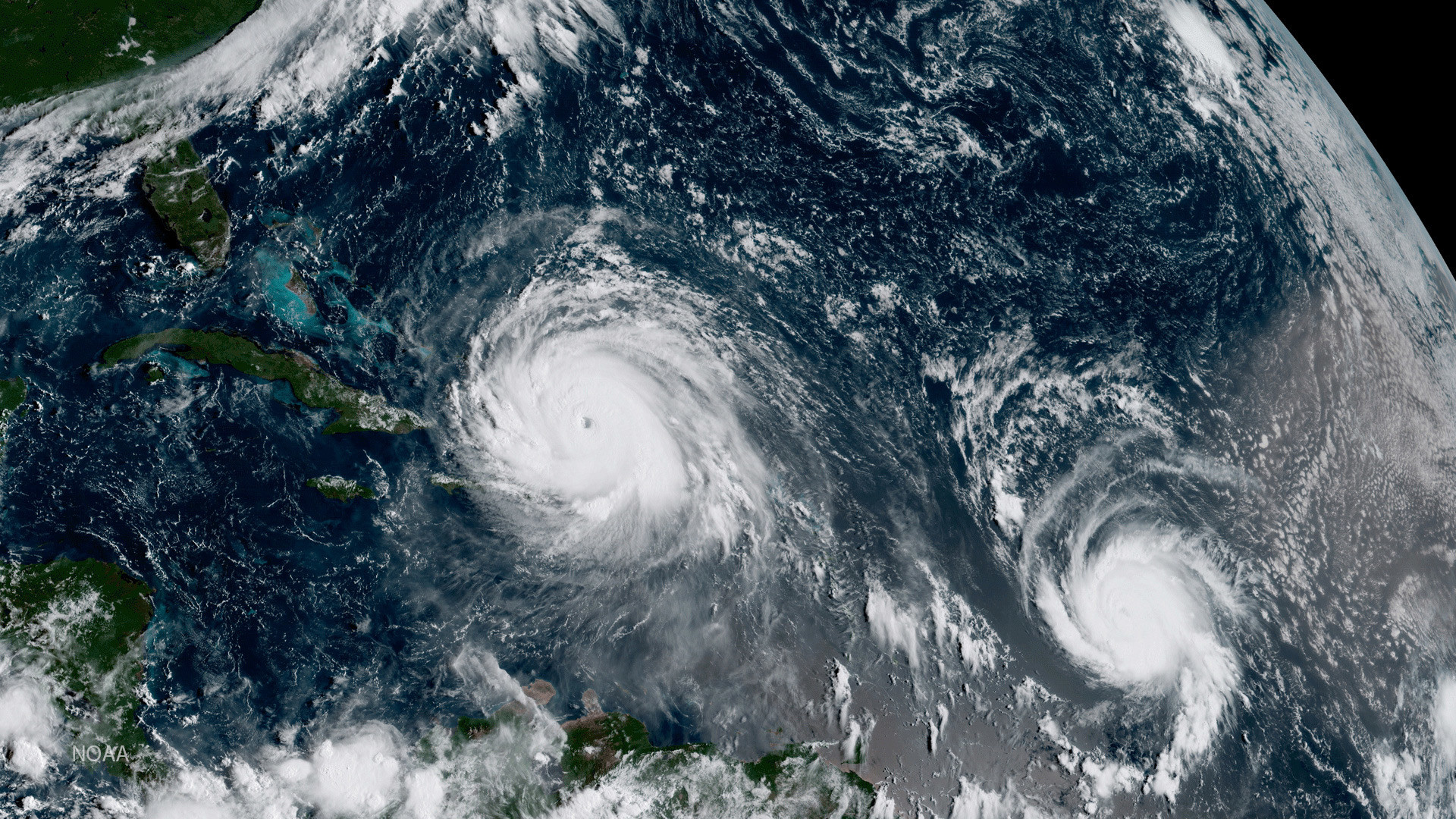 Hurricane Irma (L) and Hurricane Jose are pictured in the Atlantic Ocean in this September 7, 2017