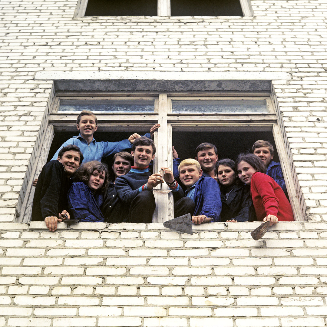 Student construction team of the Elektrostal Heavy Machine-Building Plant inside a window of a technical school under construction.