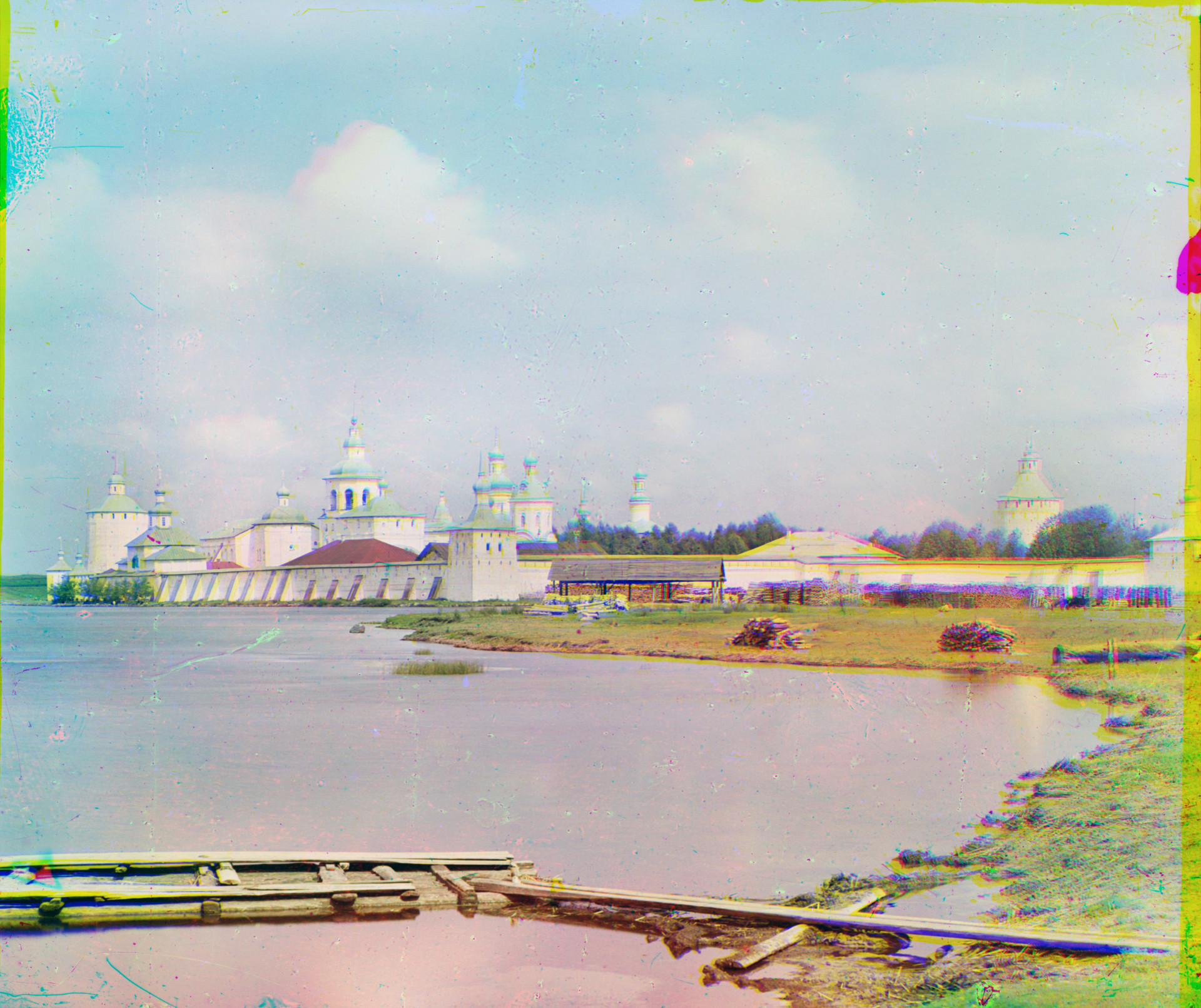 St. Kirill Belozersky Monastery. Southeast view with south shore of Siverskoe Lake. Center: Svitochnaia Tower. Summer 1909.