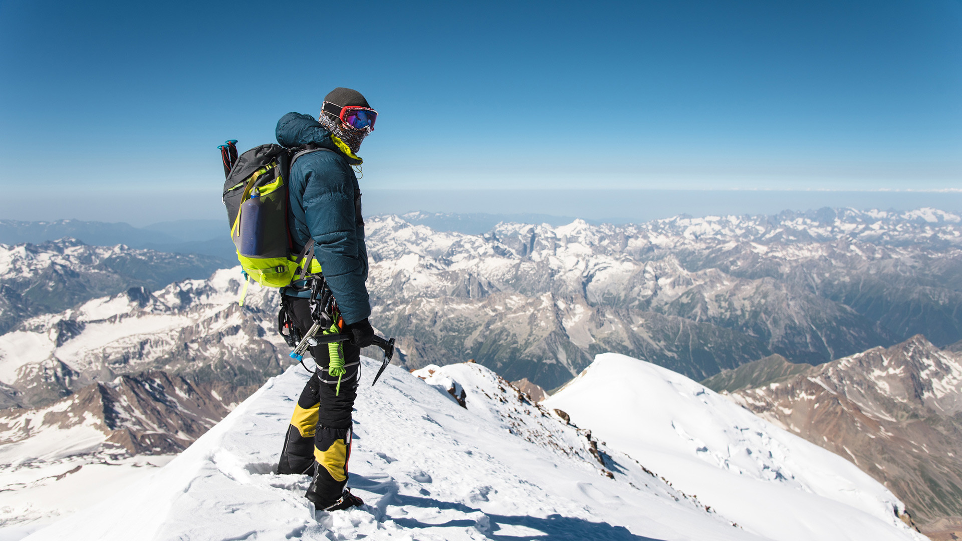 Professional guide-climber on the snow-covered summit of Elbrus sleeping volcano.