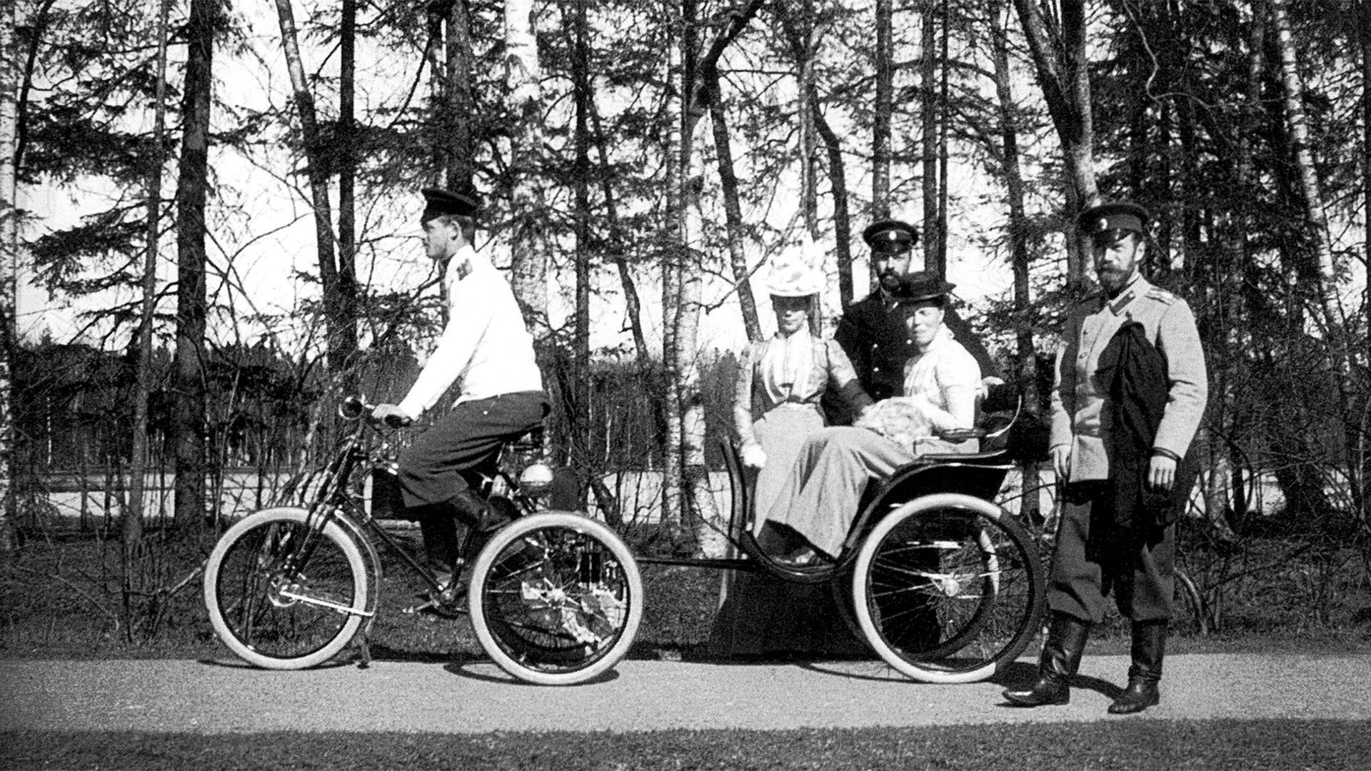 Emperor Nicholas II and his family enjoying an afternoon walk.