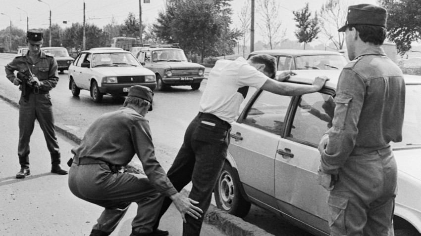 Kazan police officers detain a suspect during a raid, 1992