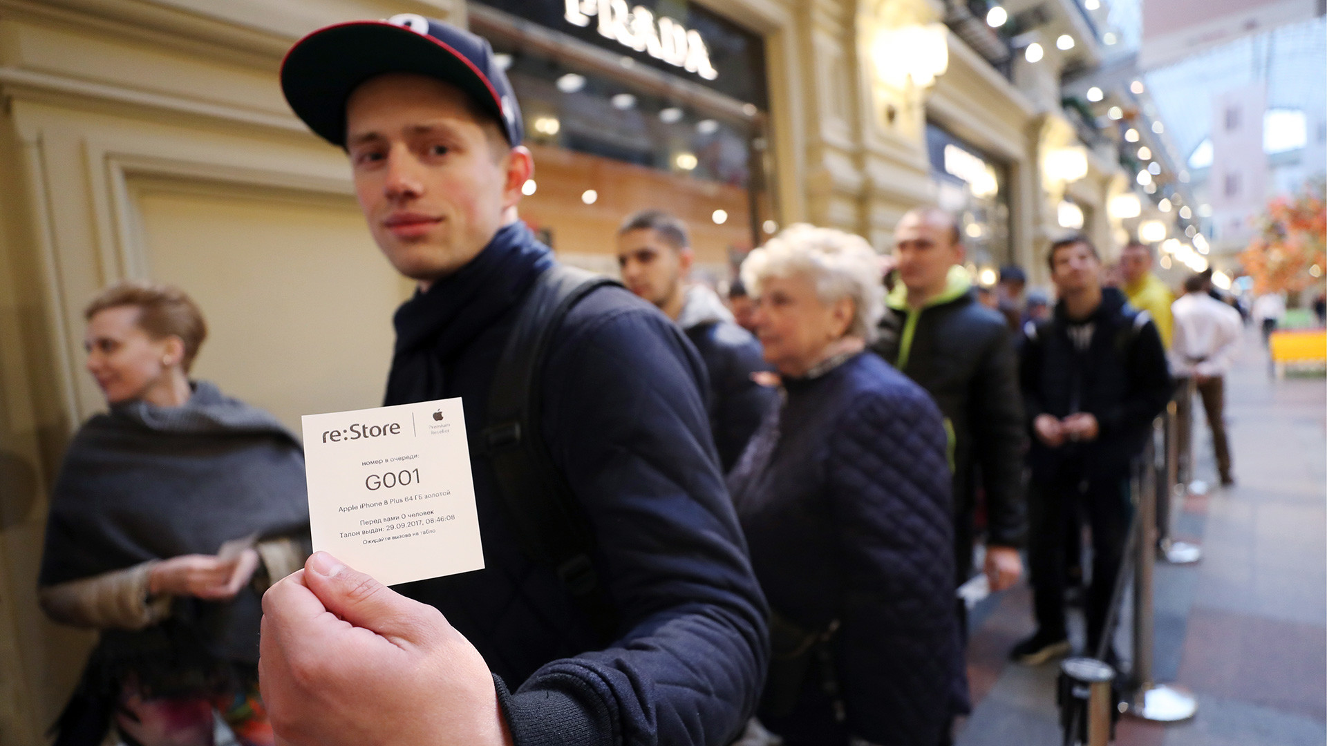 People wait in line inside the GUM department store to buy new iPhone 8 and iPhone 8 Plus as Apple's latest smartphones officially go on sale in Russia.