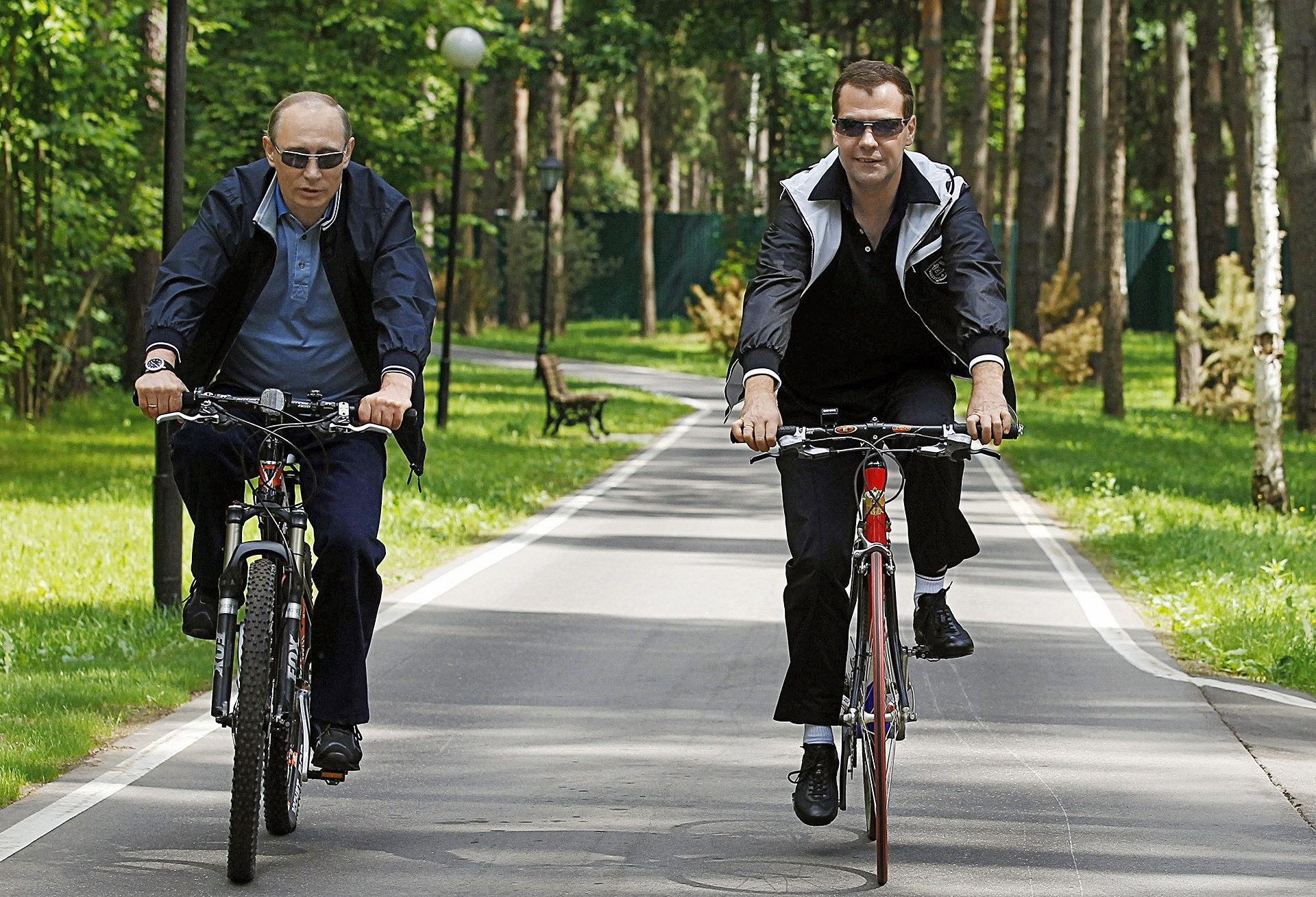 Medvedev and Putin cycling during an informal meeting at the Gorki residence
