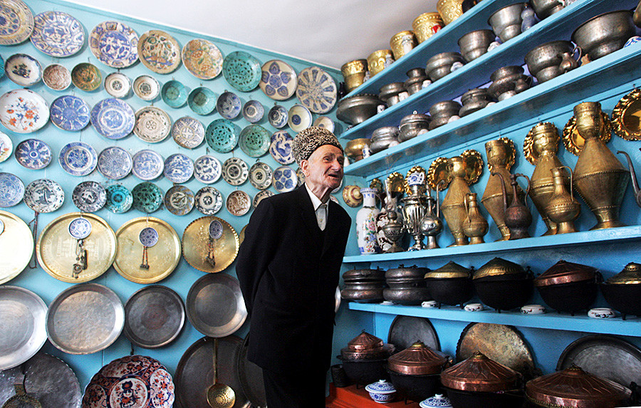 Kubachi elder Gadzhiomar Izabakarov, 79, shows off his life-long collection of engraved silverware in his mini-museum at his home in Kubachi May 13, 2010