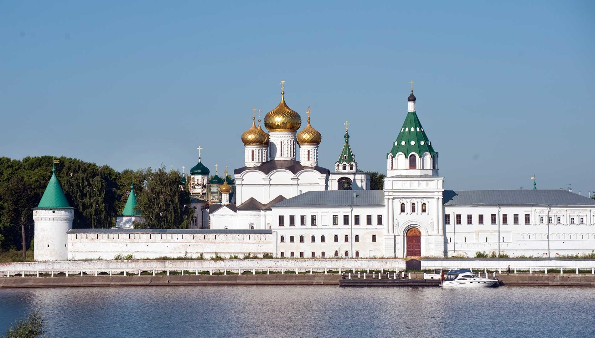 Trinity-Ipatiev Monastery, east view across Kostroma River. From left: Water Tower; Cathedral of Nativity of the Virgin; Trinity Cathedral; bell tower; Archbishop's Cloisters with Gate Church of Sts. Chrysanthus & Daria. Aug. 13, 2017.