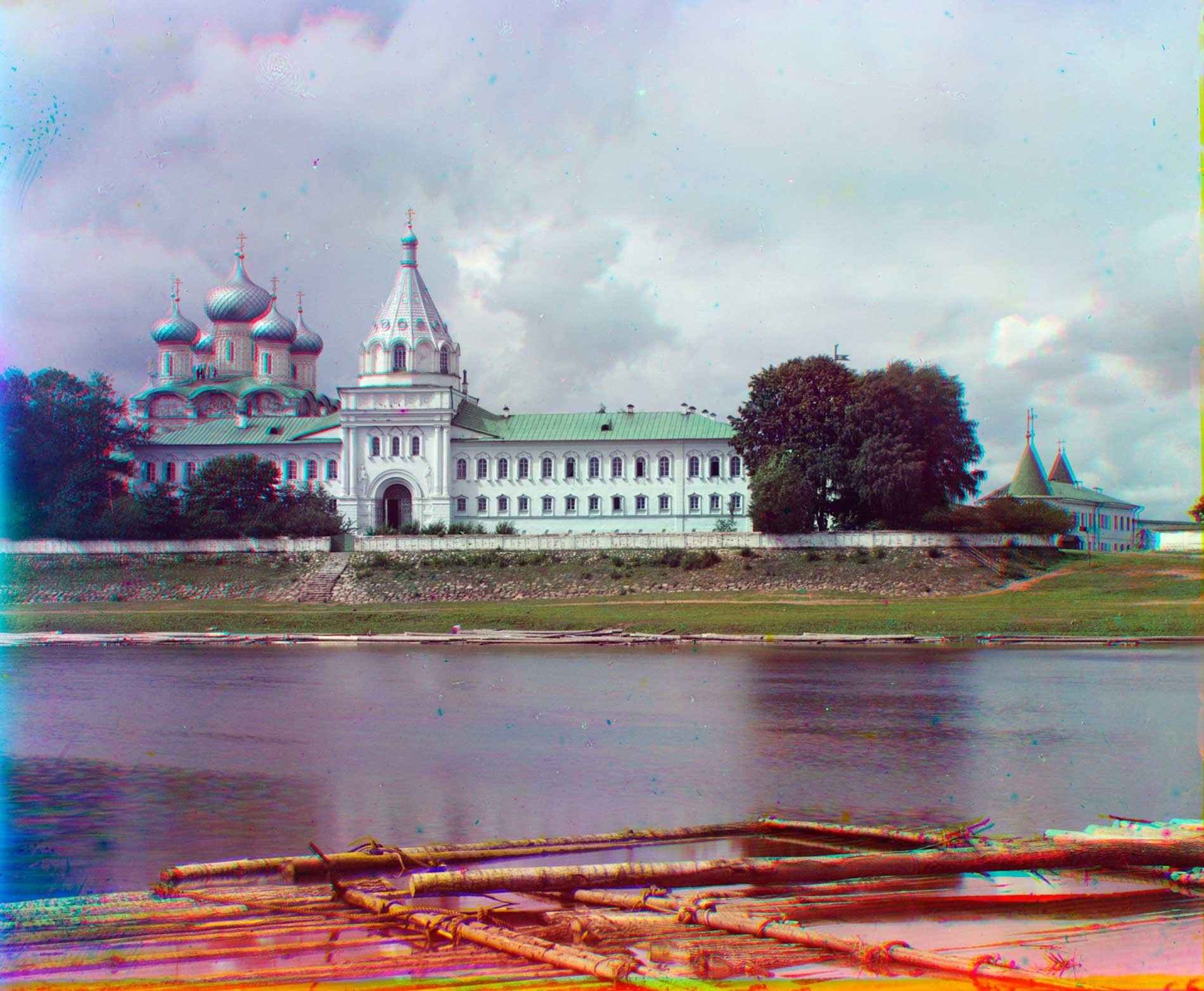 Trinity-Ipatiev Monastery, east view across Kostroma River. From left: Trinity Cathedral; bell tower; Archbishop's Cloisters with Gate Church of Sts. Chrysanthus & Daria; Powder Tower. Summer 1911.