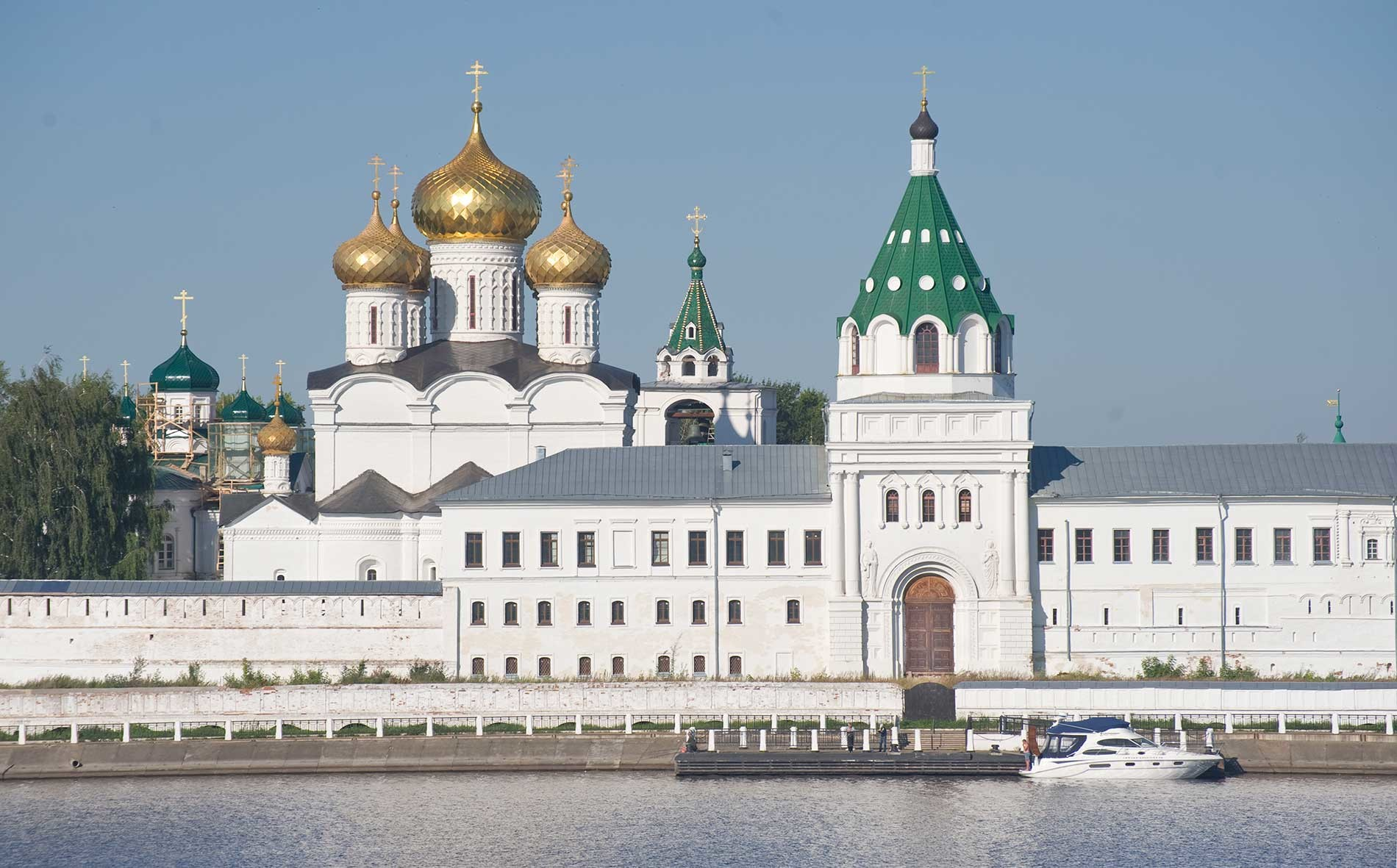 Trinity-Ipatiev Monastery, east view across Kostroma River. From left: Cathedral of Nativity of the Virgin; Trinity Cathedral; bell tower; Archbishop's Cloisters with Gate Church of Sts. Chrysanthus & Daria. Aug. 13, 2017.