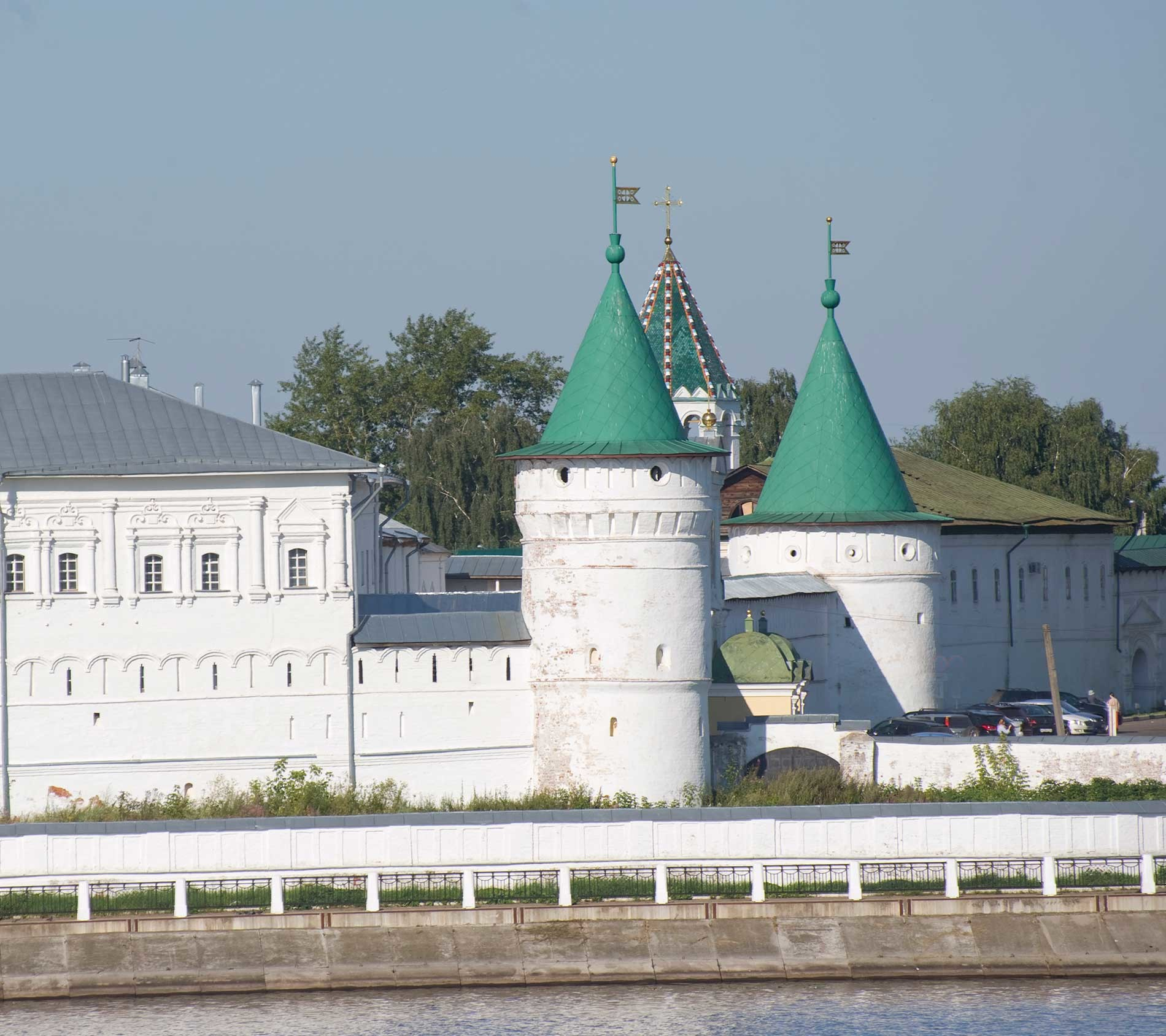 Trinity-Ipatiev Monastery, east view across Kostroma River. From left: Archbishop's Cloisters; Powder Tower; Green Tower (background); Catherine (North) Gate; Smithy Tower. Aug. 13, 2017.