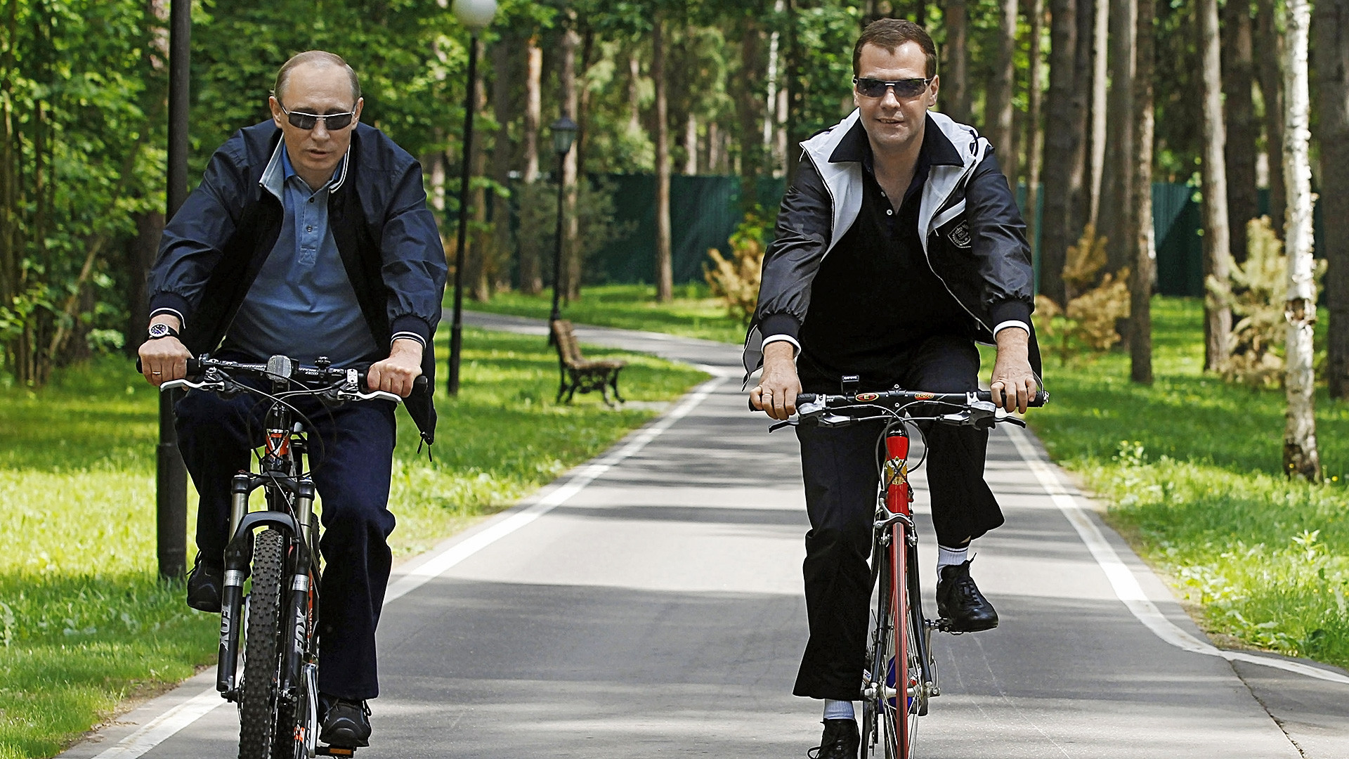 Russian President Dmitry Medvedev, right, and Prime Minister Vladimir Putin, left, cycling during an informal meeting at the Gorki residence.