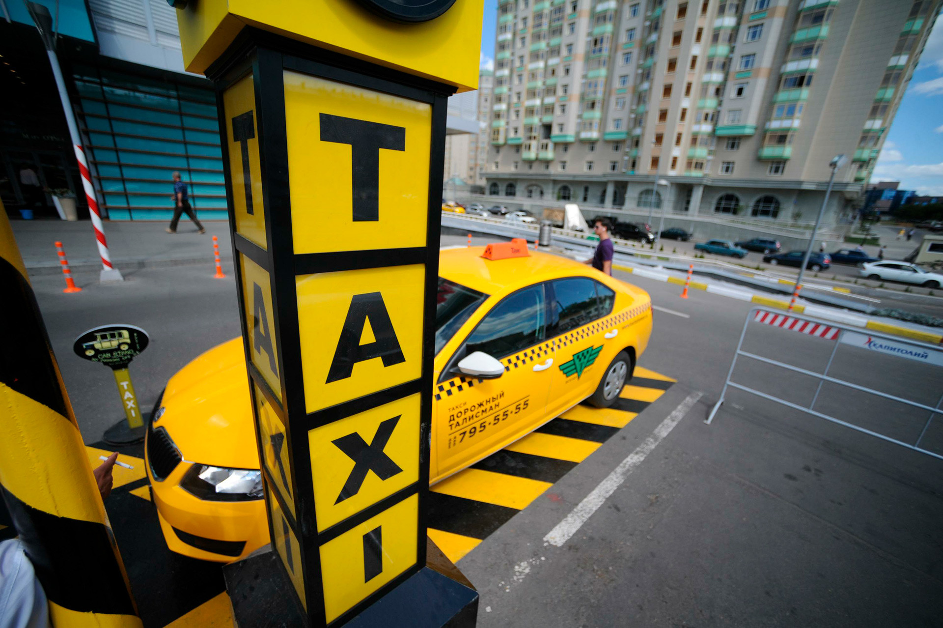A taxi cab parking in Moscow.
