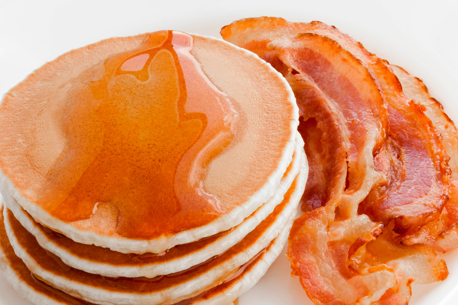 Pancakes with maple syrup and bacon.