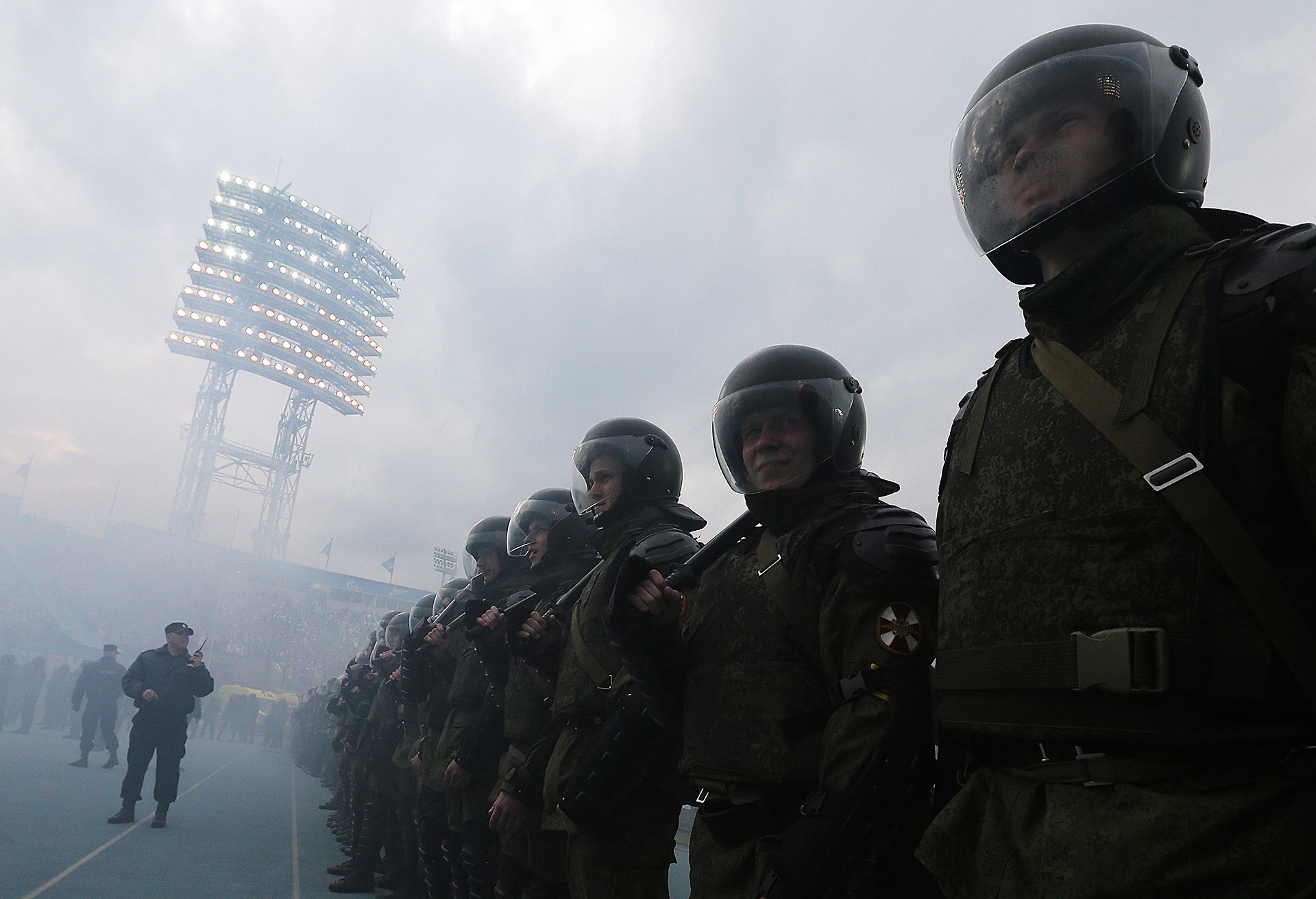 Police officers seen as football fans set off flares after the 2014/15 Season Russian Premier League.