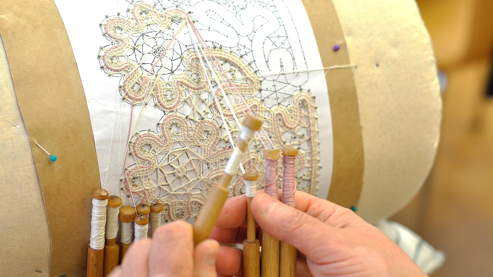 Vologda lace is entirely handmade with wooden bobbins.