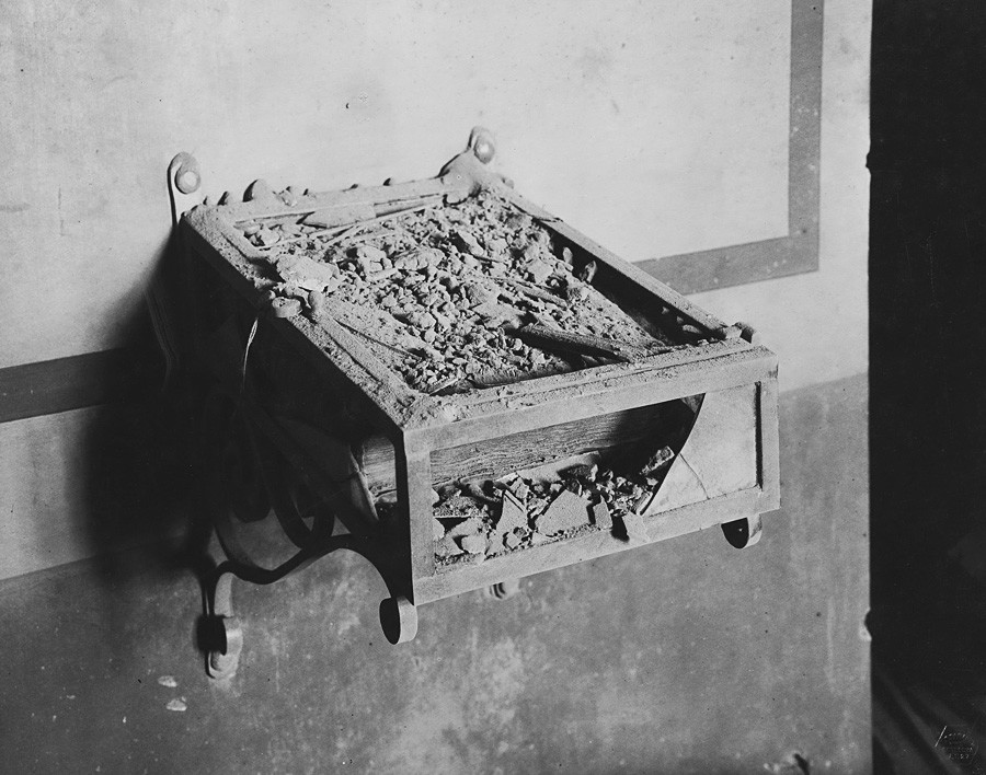 Broken display case with the gospel of Mistislav in the Patriarch's Vestry after the bombardment of the Moscow Kremlin. Photograph by P.P. Pavlov. Nov. 14 , 1917.