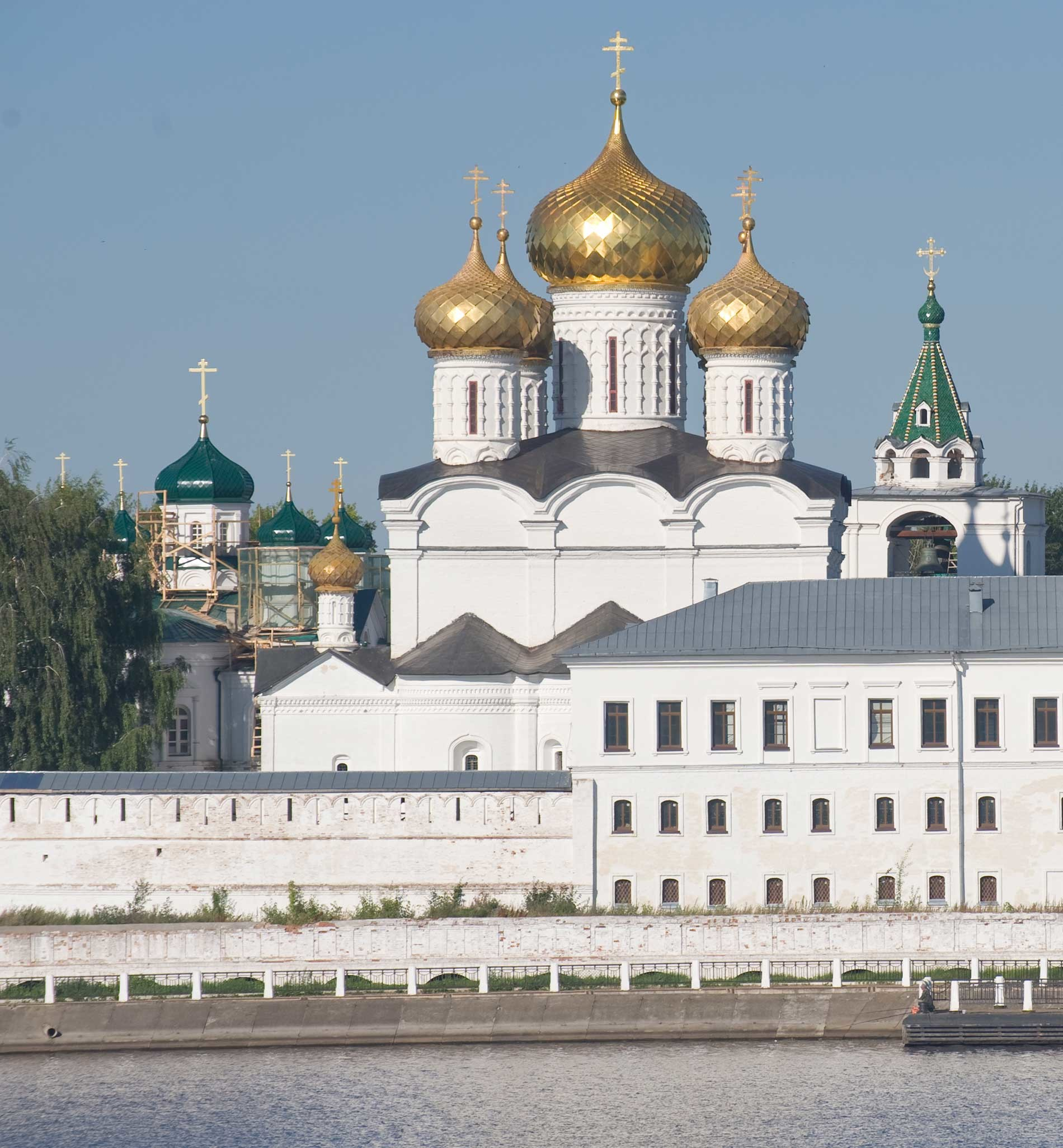 Trinity-Ipatiev Monastery. From left: Cathedral of Nativity of the Virgin; Trinity Cathedral; bell tower. East view across Kostroma River. Aug. 13, 2017.