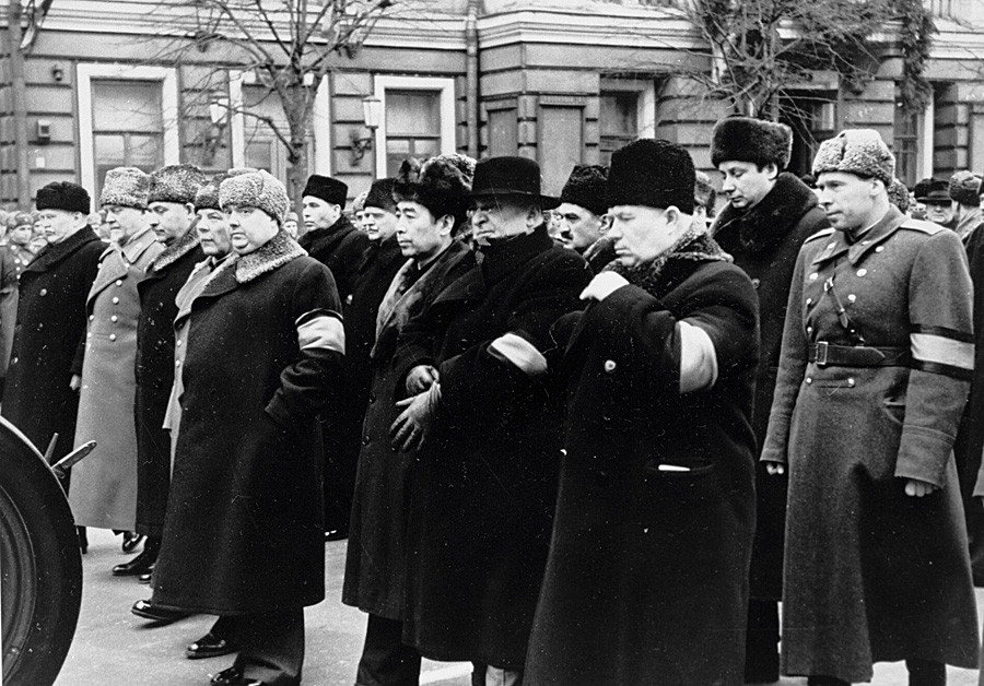 The middle row, from right to left: Nikita Khrushchev and Lavrentyi Beria among other officials at the funeral procession of Josef Stalin
