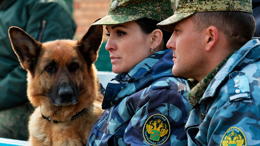 Russian customs officials with a dog