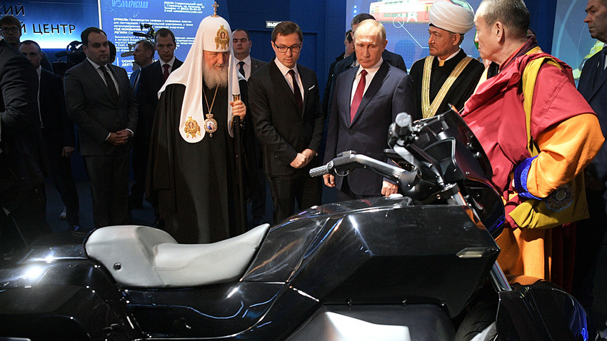 Vladimir Putin during his visit to Russia Focused on the Future multimedia exhibition and forum at the Manezh Central Exhibition Hall in Moscow