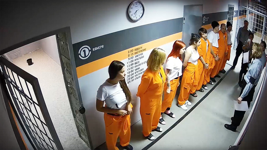 Participants of the Experiment 12 show, trying to win money and fame, live lives of prisoners