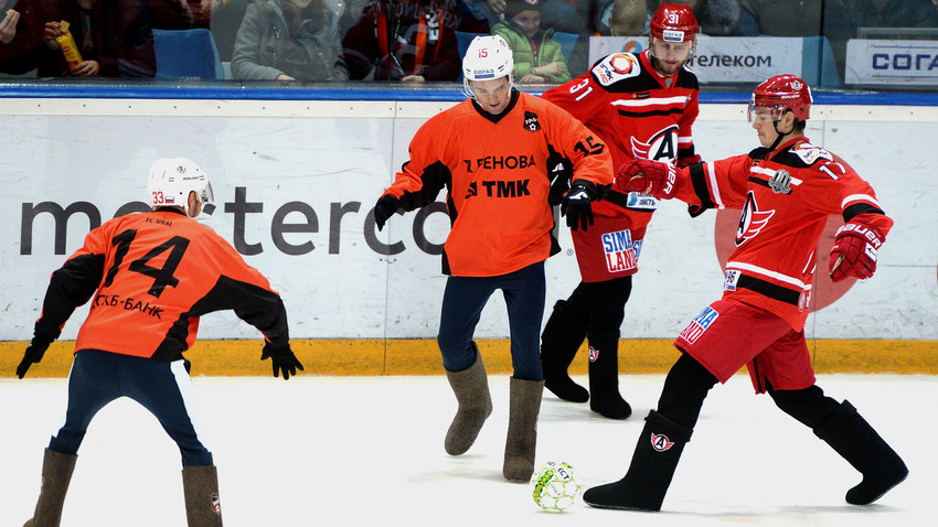 Several of the county's leading football and ice hockey players took to the rink wearing valenki - felt boots - to play a game of improvised football and hockey.