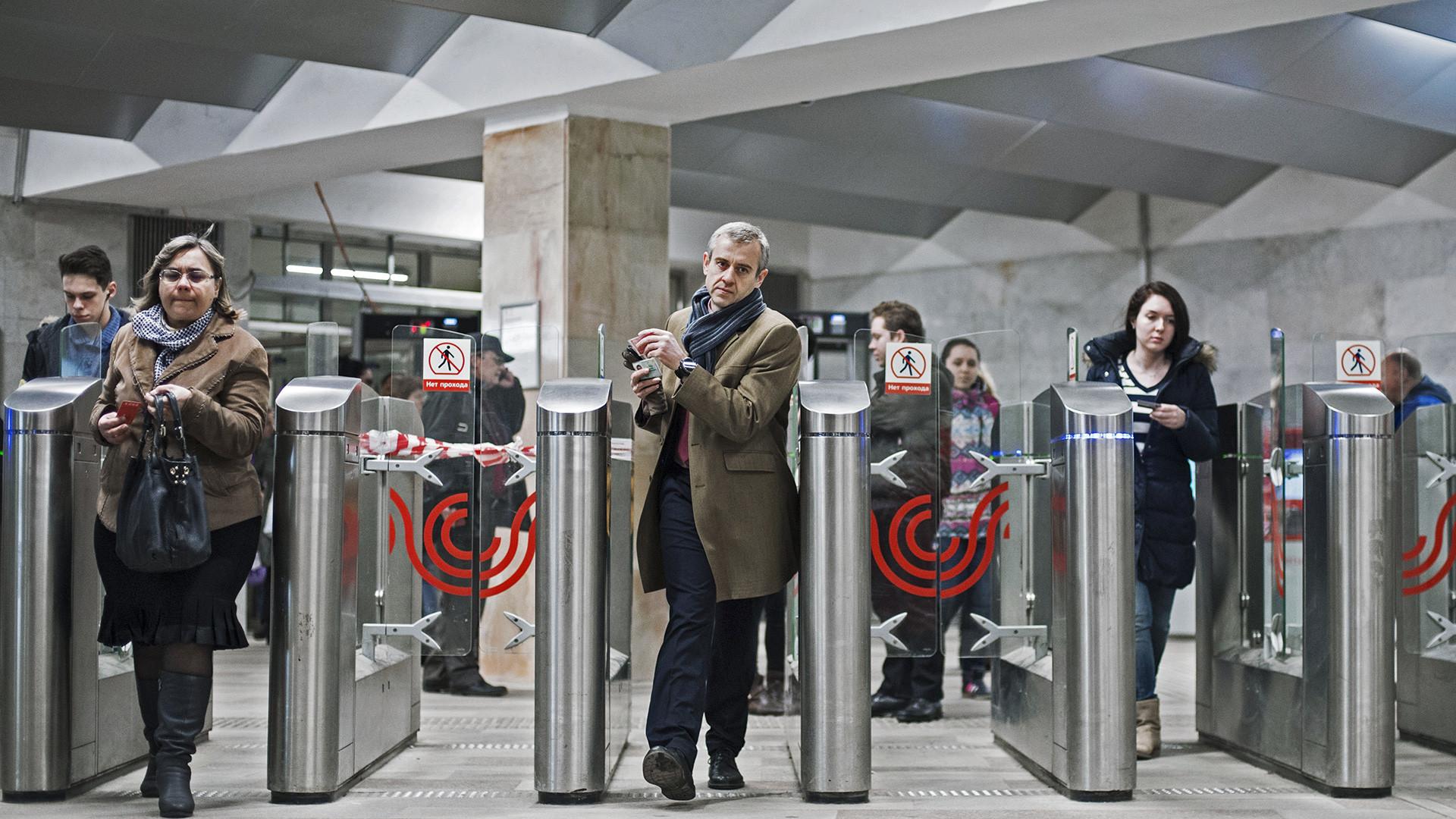Passengers pass turnstiles at the Serpukhovskaya station of the Serpukhovsko-Timiryazevskaya Moscow metro line.