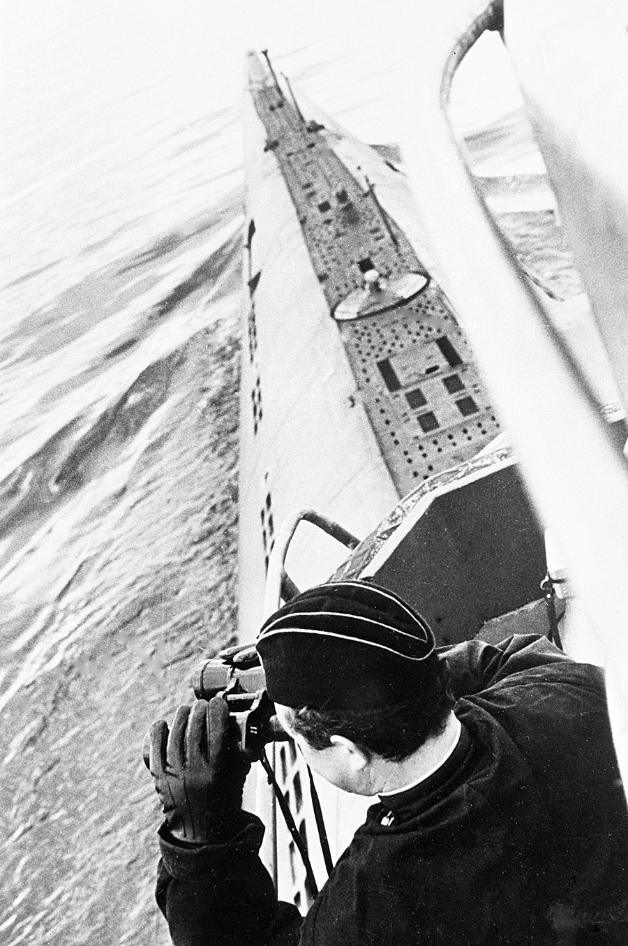 Soviet submarine commander scans the horizon through binoculars in 1968