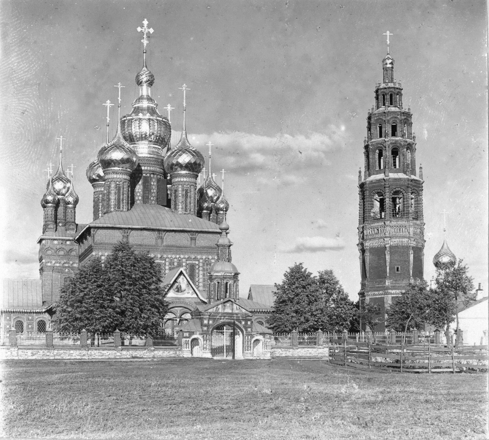 Church of Decapitation of John the Baptist, with bell tower. West view. Right: Ascension Church (not extant). Summer 1910.