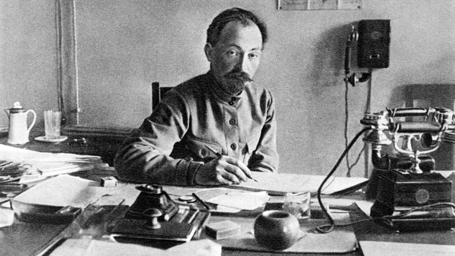 'Iron Felix' behind his working table. Maybe he is signing execution orders - or, perhaps, establishing another orphanage.