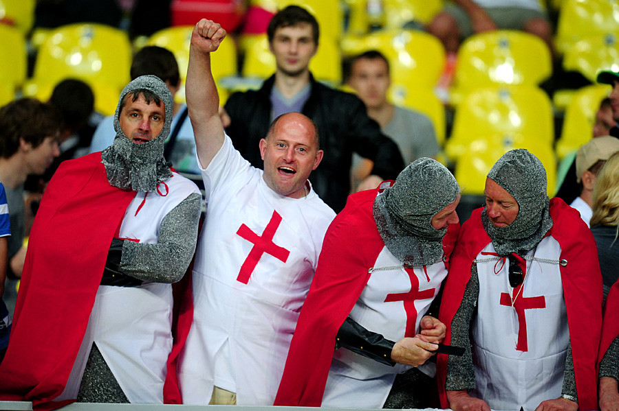 Supporters of the English team watch action in the RWC Sevens 2013 Men's Tournament Final match between England and New Zealand at Luzhniki Stadium