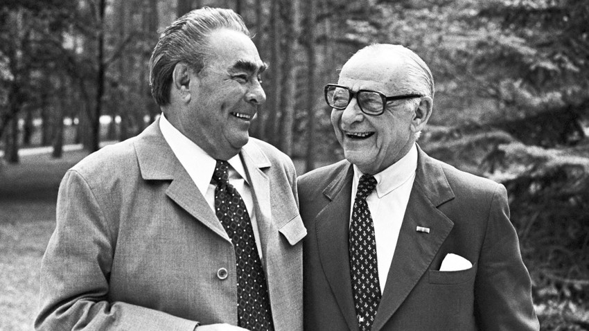 Leonid Brezhnev and Armand Hammer talk during a meeting.