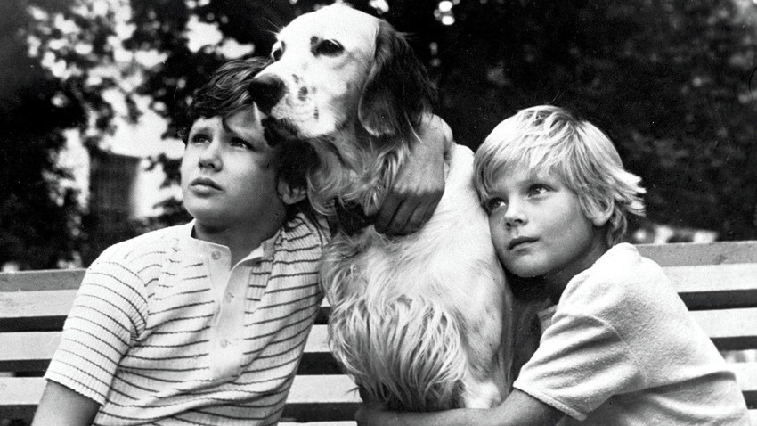 "Kids with a dog in a scene from the movie ""White Bim the Black Ear"" based on the story by Gavriil Troyepolsky"