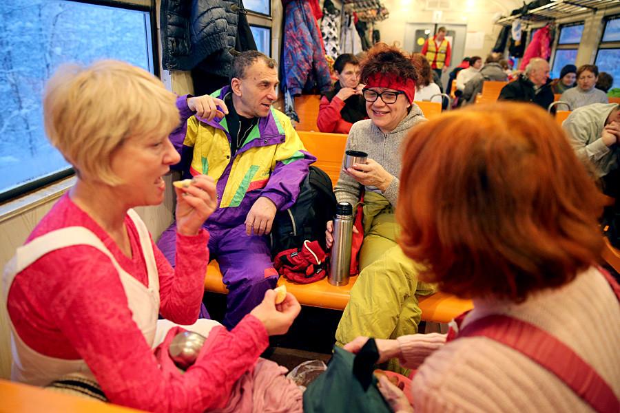 People on a 'Lyzhnaya Strela' (Ski arrow) train, a free of charge train which takes people to ski-runs.