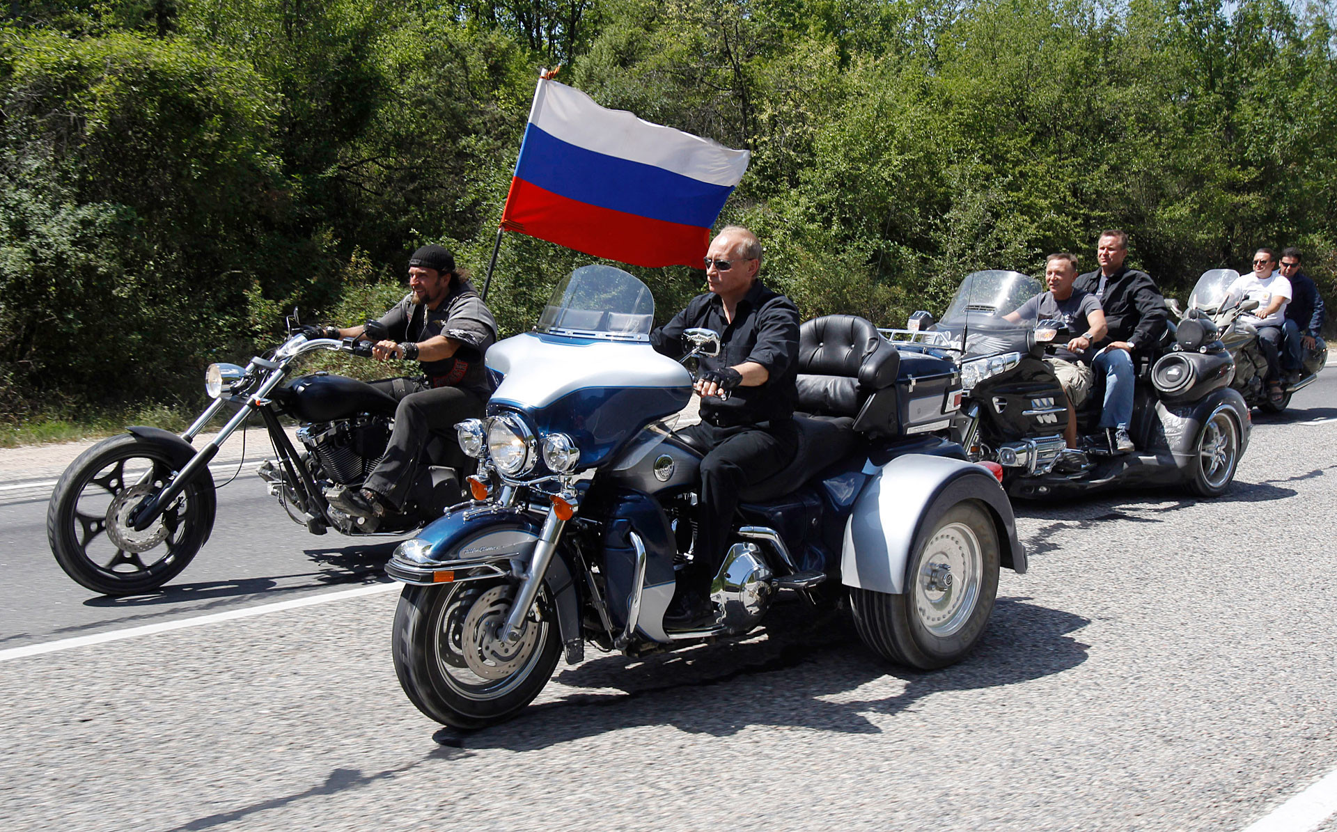 Vladimir Putin rides a Harley Davidson Lehman Trike as he arrives for a meeting with Russian and Ukrainian bikers.