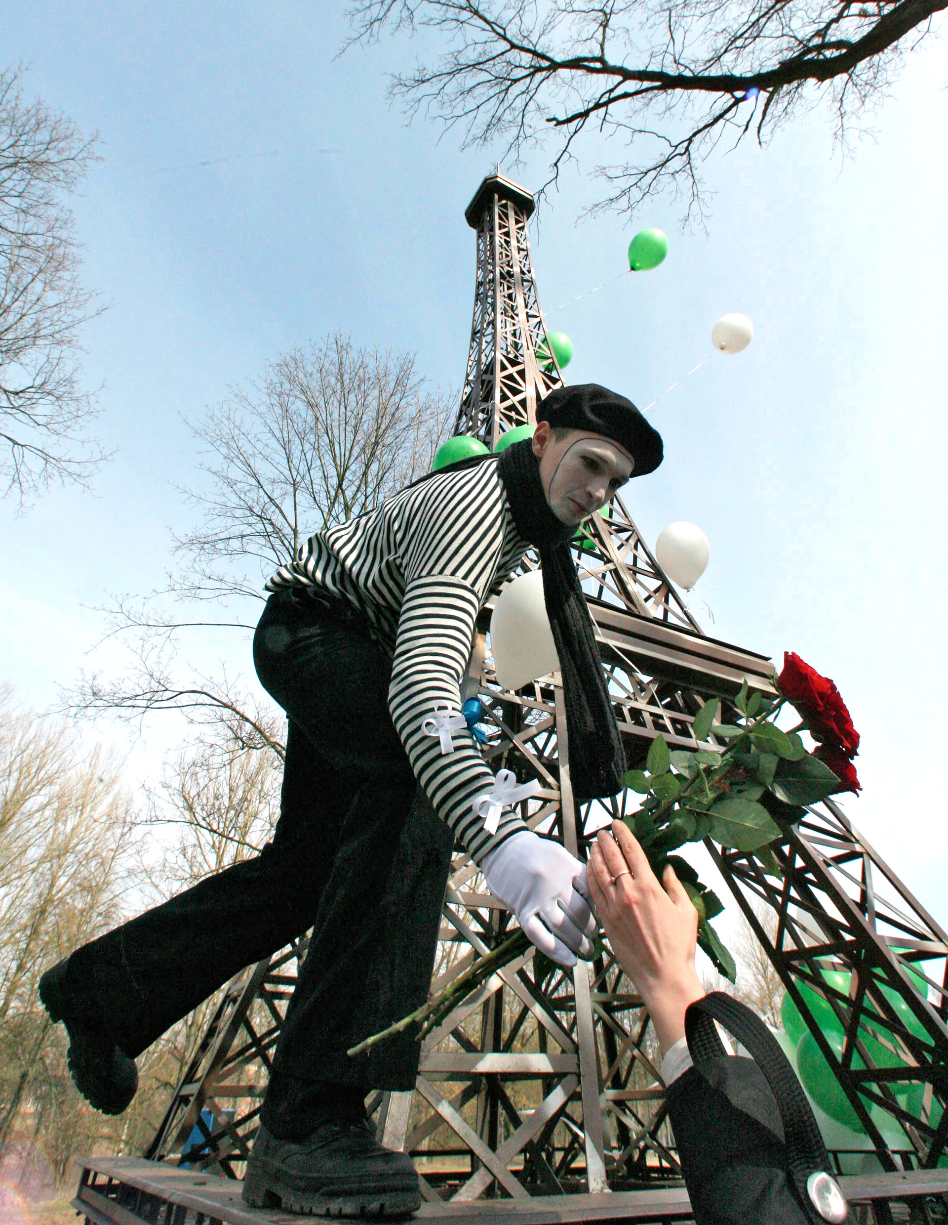 Outdoor festivities to mark the 120th anniversary of the Eiffel Tower near its 8-meter-tall copy in the town park of Gusev, Kaliningrad Region.