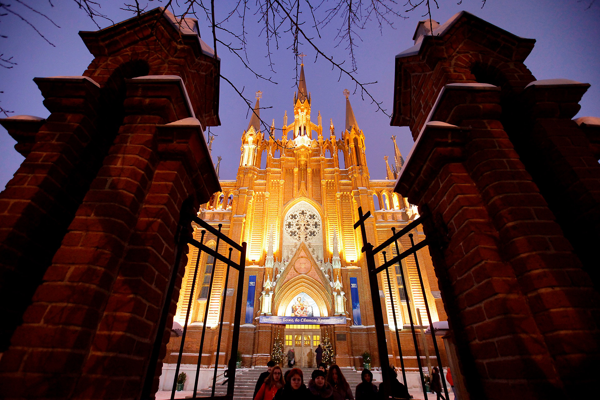 Believers near the Roman Catholic Cathedral of the Immaculate Conception of the Holy Virgin Mary during Catholic Christmas celebrations in Moscow.