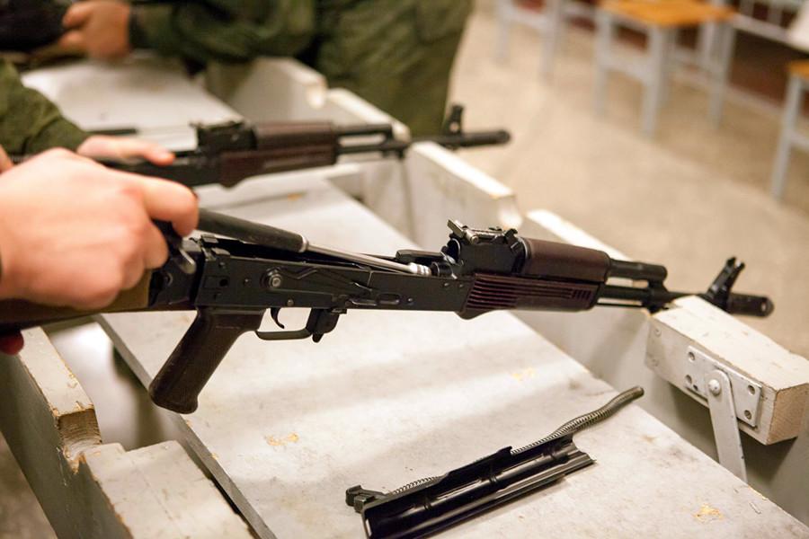 Disassembly of Kalashnikov automatic rifle.