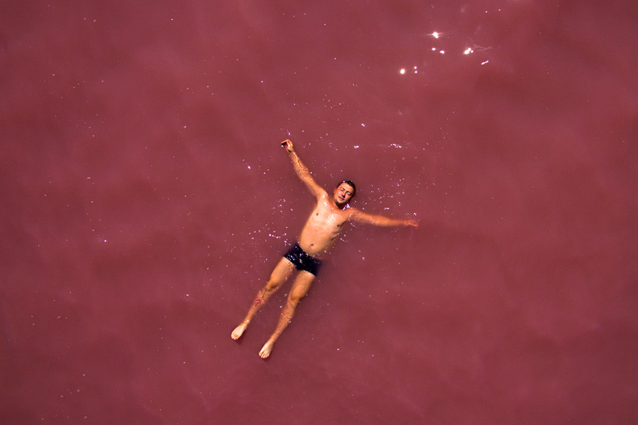 "A man is resting in the salty ""Malinovoe ozero"" (Raspberry Lake) in the Altai Region."