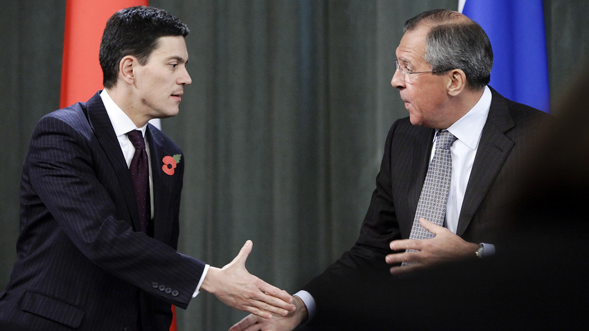 Russian Foreign Minister Sergey Lavrov, right, shakes hands his visiting Britain's counterpart David Miliband, left, during their news conference meeting in Moscow, Nov. 2, 2009