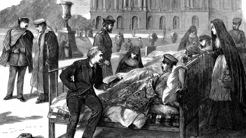 Daniel Home reading to wounded German officers in the military hospital at Versailles. Franco-Prussian War, 1870. From The Graphic. (London, 26 November 1870).