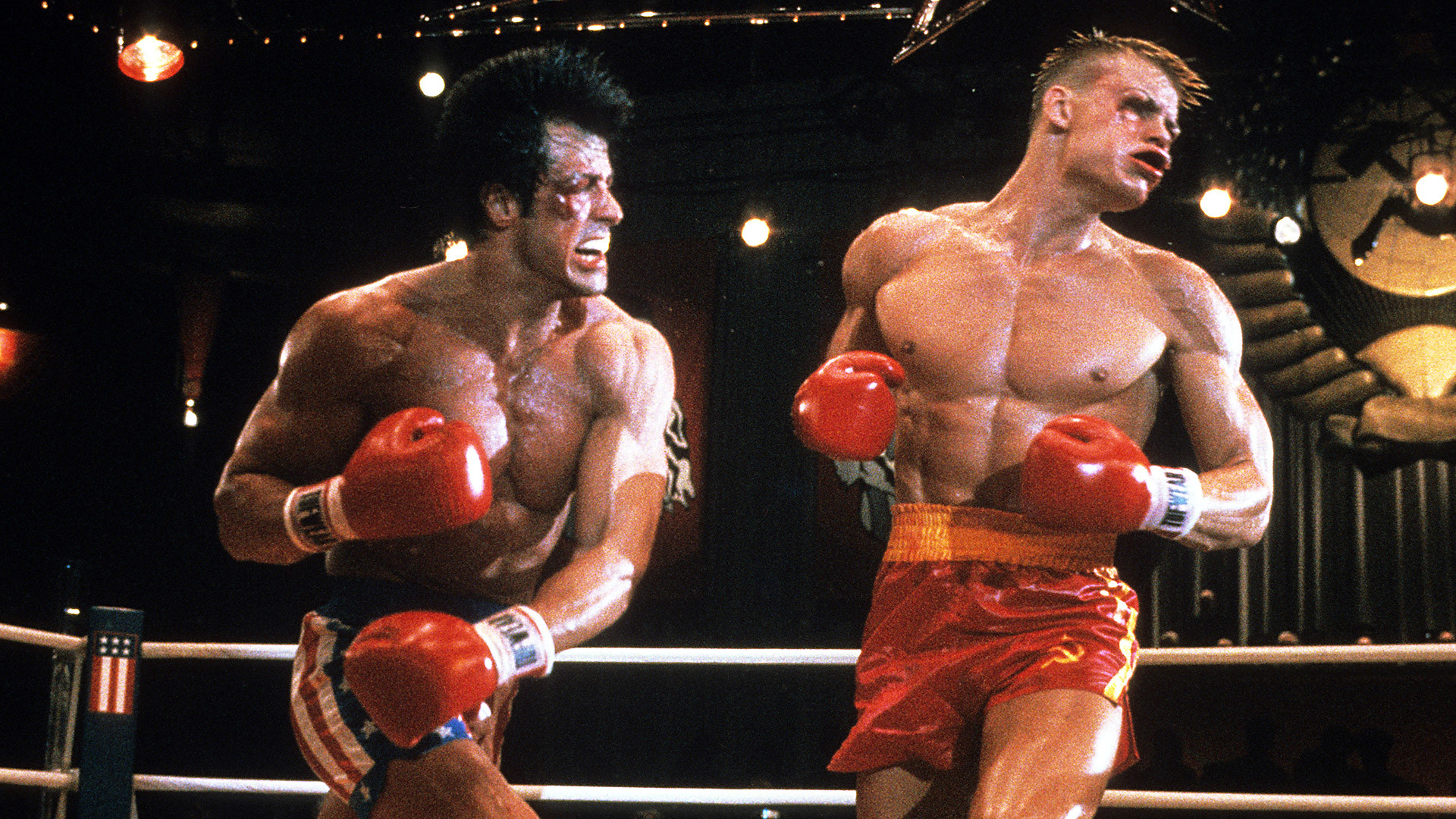 Stallone punches Dolph Lundgren in a scene from the film 'Rocky IV', 1985.