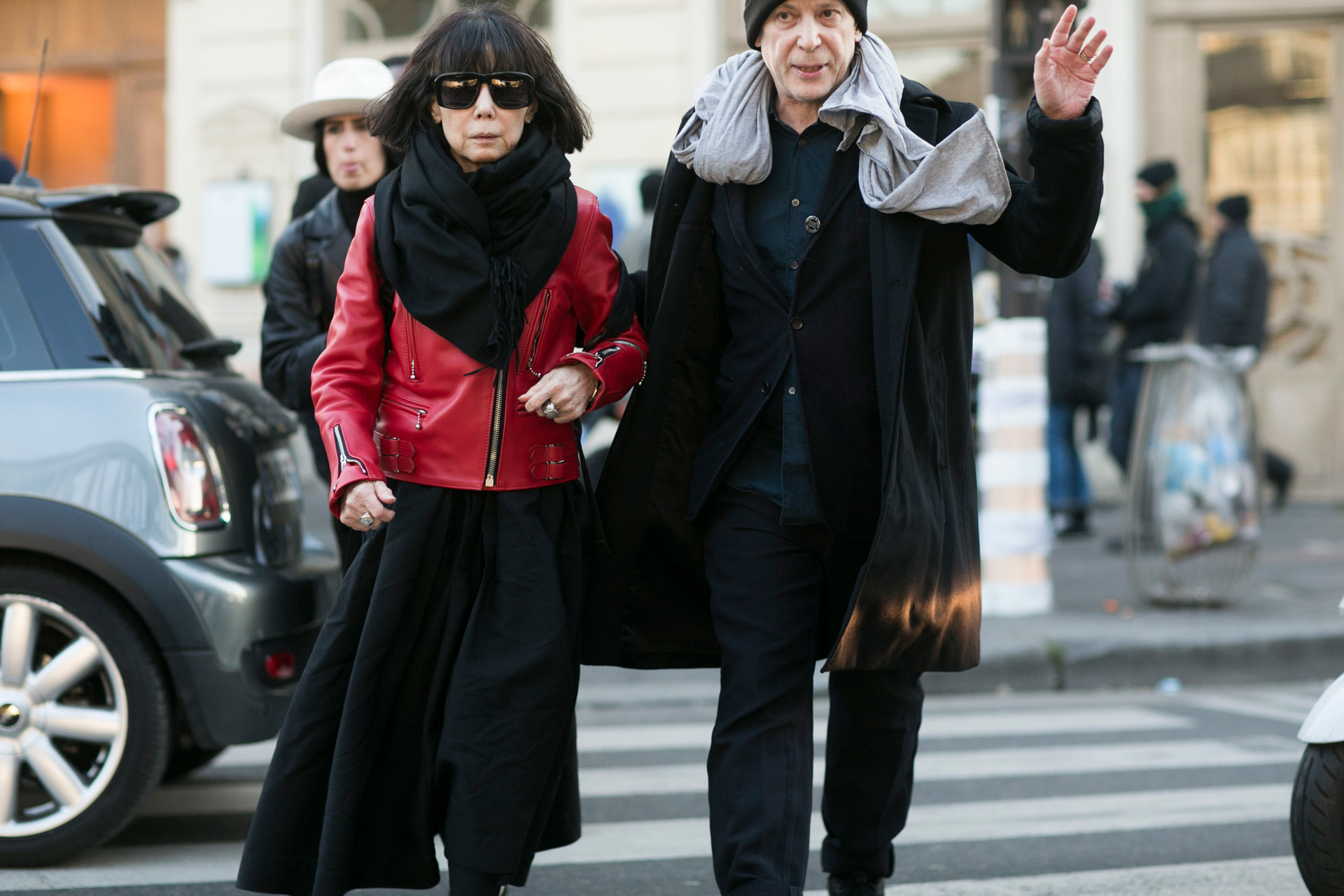 Rei Kawakubo, Comme des Garcons creative director, and Adrian Joffe, Dover Street Market and Comme des Garcons presiden, exit the Gosha Rubchinskiy show on Jan. 21, 2016 in Paris, France.