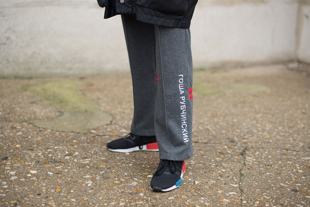Leah Angeles poses wearing Gosha Rubchinskiy pants and Adidas shoes after the Maison Margiela show at the Grand Palais during Paris Fashion Week Womenswear FW 17/18.