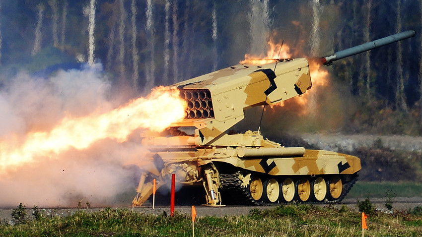 "A TOS-1 ""Buratino"" heavy flamethrower system firing at the 10th Anniversary International Exhibition of Arms, Military Equipment and Ammunition ""Russia Arms Expo 2015"" on the grounds of the Nizhny Tagil State Demonstration and Exhibition Center of Armament and Military Equipment."