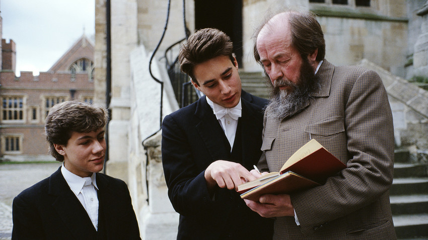 Russian writer Aleksander Solzhenitsyn, stops to sign his autograph and talk to pupils outside Eton College Chapel, in Eton, U.K., May, 1983