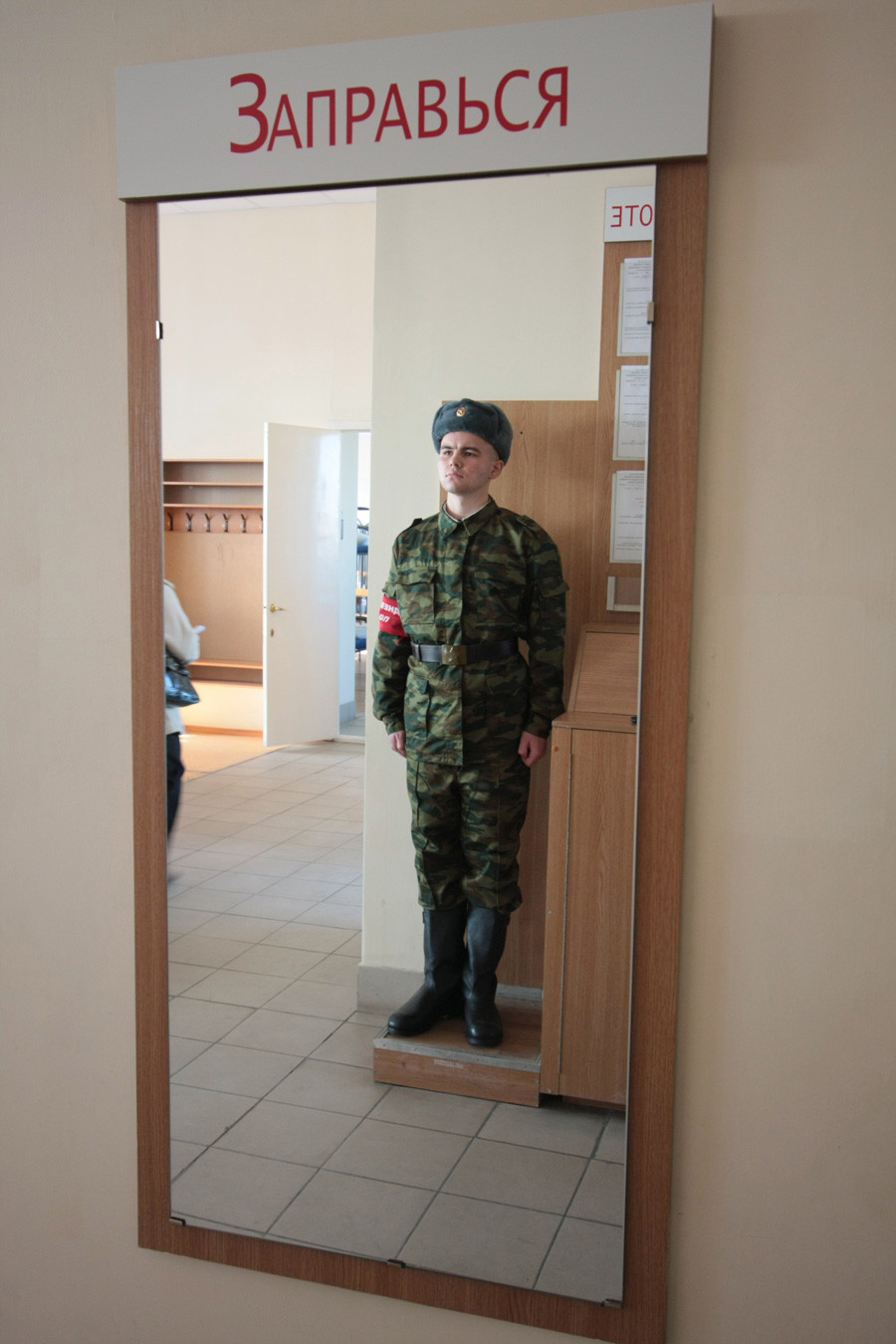 Barracks soldier is on duty at Patriot enlistment office in Kazan.