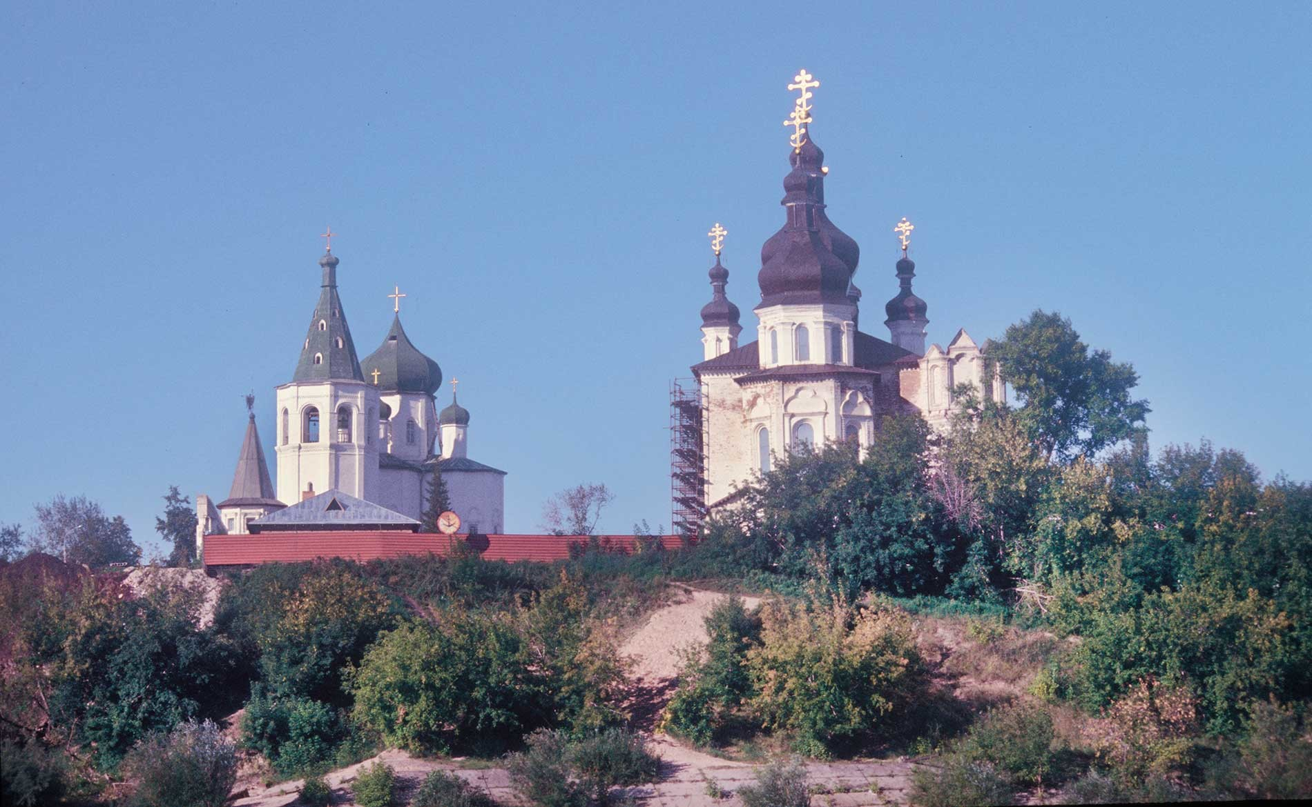 Tyumen. Trinity Monastery. Church of Sts. Peter and Paul (left), Trinity Cathedral. East view from Tura River. Sept. 4, 1999.