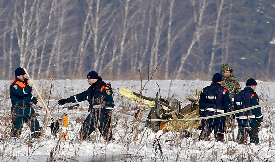 Personnel work at the scene of a AN-148 plane crash in Stepanovskoye village, about 40 kilometers (25 miles) from the Domodedovo airport, Russia.